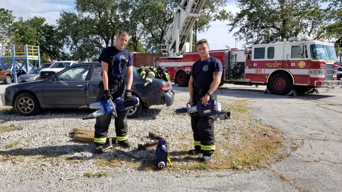 Two Firefighters Holding Jaws of Life